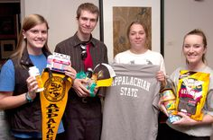 Appalachian State University's Student Government Association is ensuring that four students currently serving in the N.C. Army National Guard in Afghanistan have lots of holiday reminders from their university family. SGA spearheaded a drive to collect university-logoed apparel, pennants and flags, as well as snacks, drink mixes, toiletries, magazines and games to fill care packages for the soldiers.