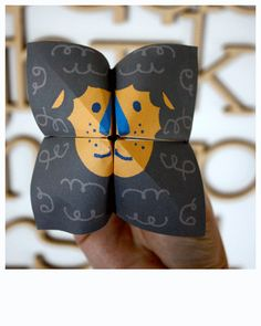 Roaring lion - cootie catcher (origami fortune teller). From  Moodkids. Note: The website is in Dutch there are pictorial instructions at the bottom of the page.
