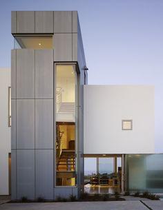 Steel-troweled stucco, glass and Rheinzink