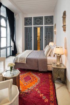 Nestled in one of the oldest neighborhoods of Marrakech, near the Medina, is Riad Adore. J'adore, j'adore! From the greyish blue metal and woodwork to the classic Moroccan architecture, this restored riad is filled with charm and reason #857 why I need to visit Morocco. Stat.