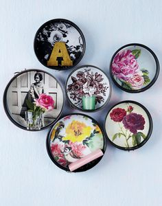 Use a group of baking tins as shallow shelving. Decoupage the base of each tin with a pretty photo so they double up as picture frames.