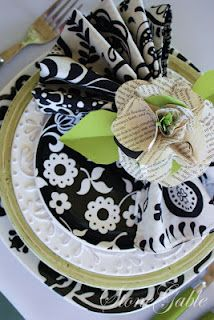 . . .black & white dinnerware with green...so pretty tablesetting
