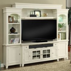 Take your living room in a coastal direction with this grand entertainment center.