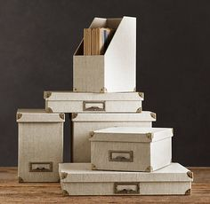 In small spaces, office supplies might show, so camouflage them to match the wall color in linen.