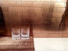 This copper subway tile is visually striking & will bring a modern feel to any space. Shop copper stainless steel wall tiles here. Copper Tile Backsplash, Kitchen Backsplash, Penny Tile, Decorative Borders, Copper Kitchen, Steel Wall, Copper Metal, Subway Tile, Wall Tiles