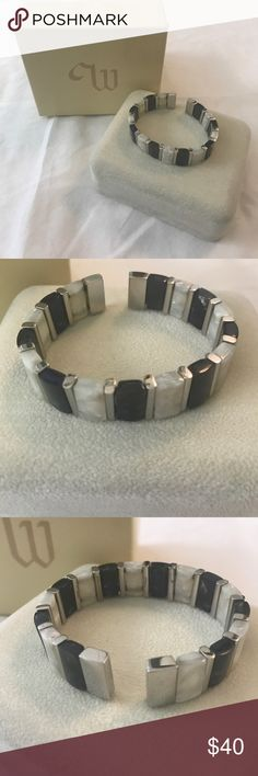 Stainless steel bangle with black and ivory stones Stainless steel bangle with black and ivory stones by Whitehall Co. Jewellers. Never been worn and comes with original case and box. Whitehall Co. Jewellers Jewelry Bracelets