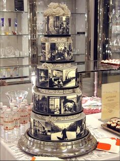 """©Sugrdva - Je T'aime wedding cake for Bloomingdales Elegant black and white romantic French photographs, handmade white roses, diamond flower pins. Each cake sits on it's own black satin ribbon edged silver base. Created for Bloomingdale's """"Wedding Party."""""""