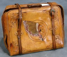 Suitcase (this was probably tooled & made in Mexico)