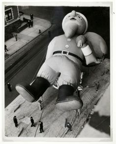 Weegee, [Inflating Santa Claus for the Macy's Thanksgiving Day Parade, New York], November 21, 1940
