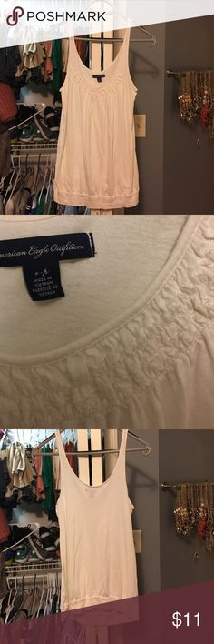 Off white American Eagle tank Size Small. Semi sheer off white with gorgeous cinching!! Perfect condition! No wear. Worn 1 time. American Eagle Outfitters Tops Tank Tops