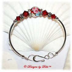 Designs by Debi Handmade Jewelry Red, Blue and Yellow Aloha Floral and Swarovski Crystal Siam Red Bicones Sterling Silver Plated Curved Tube Fitted Bangle Bracelet with Hook Clasp $20