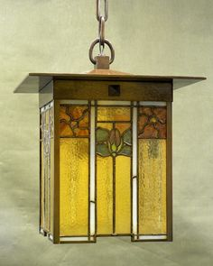 This photo provided by Michael Adams shows a Michael Adams Gustav stained glass lantern in the Arts and Crafts style.