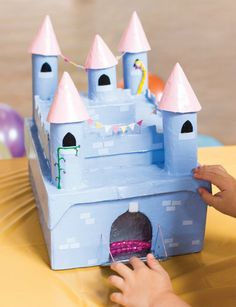 Make a secret princess castle from cardboard tubes and boxes