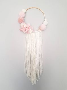 Pompom Floral Wall Hanging - Custom To Order Make your wall beautiful with this soft pompom and floral dreamcatcher! Perfect for any room! The base is a natural wood hoop made of pompoms and artificial flowers. Size guide: Approximately diameter 22cm/9inch Please do not hesitate