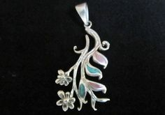 Sterling silver pendant with with  colored flover motiv.