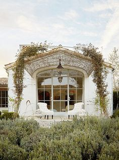 All we want to know is when can we move in?! How gorgeous is this arched steel trellis with some surrounding the Giannetti's incredible Ojai home?