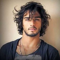 Long in front, medium hair length. Messy curly hairstyles for men