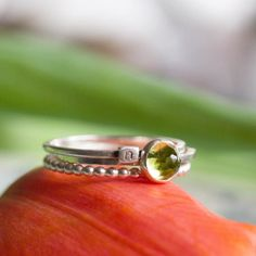 5mm Peridot Dots and initial ring make a stack for the day  #keepityours #natalkamakesjewelry #petitejoys #livecolorfully #smallthings #handmadejewelry #jewelrygram #silverjewelry #sterlingsilverjewelry #modernjewelry #gemstonejewelry #semipreciousstones #stackingrings #birthstonejewelry #peridot #alternativebridal #mothersday #stackingrings  #personalizedjewelry #initialring #initialjewelry