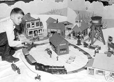 """Christmas 1931-'32 for a boy with one of Lionel's first """"0"""" gauge steam engine train sets.Looks like a #262 & T with 607,607,608 cars."""