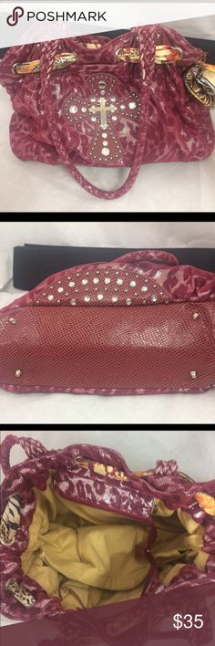 Beautiful Purse In like new condition. Rhinestones studded. Leather and canvas protection feet. 3 compartments inside. Outside pocket  can hold a cell phone. Zipper closer. Bags Totes
