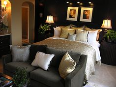 An elegant, sophisticated and romantic master bedroom with a sofa at the foot of the bed. This room almost feels fit for royalty. Notice the number and style of cushions and the overall impact they have on the look of the room