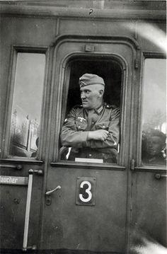 German Soldier Standing Inside A Train Door