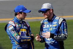 Chase Elliott, driver of the No. 24 NAPA Auto Parts Chevrolet, talks with Dale Earnhardt Jr., driver of the No. 88 Nationwide Chevrolet, on the grid during qualifying for the NASCAR Sprint Cup Series Daytona 500 at Daytona International Speedway on February 14, 2016 in Daytona Beach, Florida.