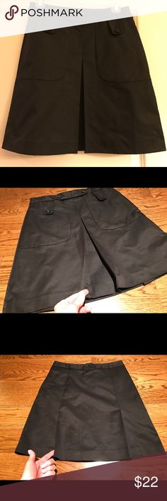"""Jacob Black A-line Skirt Front Placket Sz 0 Adorable little skirt by Jacob size 0. Color is black with button detail and placket in the front. Made out of a rich fabric with a bit of sheen to it. Fully lined. Side zipper. 18.5"""" length 26"""" waist. Smoke free and pet free home. Jacob Skirts A-Line or Full"""
