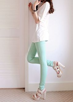 Colored pants and cream colored heels.