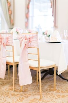 Pink bows and elegant gold chairs: http://www.stylemepretty.com/florida-weddings/brooksville-florida/2015/09/15/romantic-summer-wedding-at-southern-hills-plantation-club/   Photography: Jacqui Cole - http://jacquicole.com/