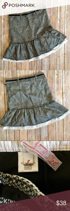 URBAN OUTFITTERS LUX Tweed Mixed Media Skirt This Urban Outfitters Lux shabby chic tweed mixed media skirt has a striped broadcloth rough cut cotton ruffle between the black lining and the tweed ruffle. Intentional distressing on the tweed hem and all around. Bow on front gives a sweet charm. Stamped metal button and side zip.   Size 3, measures approximately 14.5 inches across the waist and 29.75 inches top to bottom.  NWOT. Never worn. Lux Skirts
