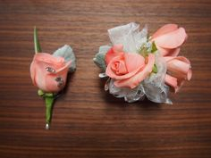 So, so pretty is this peachy colored rose and matching boutonniere with dusty miller greenery, silver & white sheer ribbons and rhinestone gems!  www.urbanelementsinteriorspace.com Portland, OR