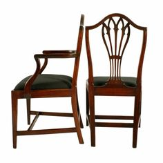 A set of eight Georgian mahogany Hepplewhite dining room chairs.  The chairs consist of six single and a pair of arm chairs with domed top rails to the back and broad pierced centre splats.  The square legs have a 'H' shaped cross stretcher and a rail between the back legs for strength.  The chairs have drop in pad seats covered in a black coloured material. Antique Dining Chairs, Dining Room Chairs, Dining Room Furniture, Arm Chairs, Wishbone Chair, Georgian, Centre, Strength, Victorian