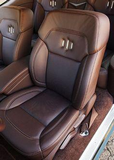 Smitty's Custom Automotive 71 chevelle green with brown interior custom door panels console seats. custom billet dash