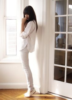 White Outfit - White jeans and white blouse. Summer clothes.