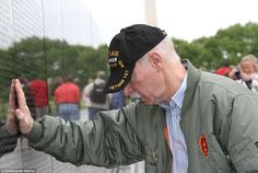 Photographer: Gaynor is pictured in a more recent photograph, honoring his fellow soldiers at the Vietnam Veterans Memorial in Washington, D.C.