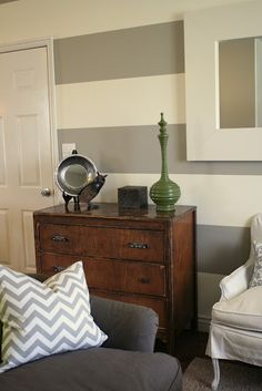Love the stripes, the wood dresser and the grey chevron