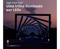 """Trilha de Led. A High Trest Trail, que fica entre Madrid e Woodward (uma cidade americana localizada em Lowa), composta por 41 """"quadrados"""", que criam um efeito de túnel. Os quadrados centrais contem luzes LED azuis que tornam ainda mais incrível o projeto durante a noite!"""