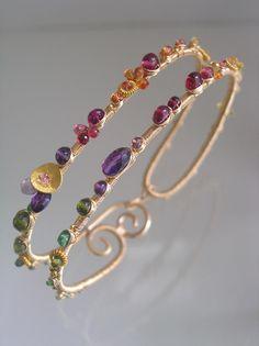 Wide Wire Wrapped Bracelet, Colorful Gemstone Bangle, Cosmopolitan Jewelry, Sapphire, Amethyst, Ruby, Tsavorite, Original Design, Signature by bellajewelsII on Etsy https://www.etsy.com/listing/196369593/wide-wire-wrapped-bracelet-colorful