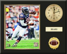 One 8 x 10 inch Chicago Bears photo of Julius Peppers inserted in a gold slide-in frame and mounted on a 12 x 15 inch solid black finish plaque.  Also features a 3-inch Arabian gold-faced clock, a customizable nameplate* and a 2-inch football medallion with a gold base.  $59.99 @ ArtandMore.com