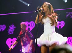 Ariana Grande Photos - Recording artist Ariana Grande performs onstage during…