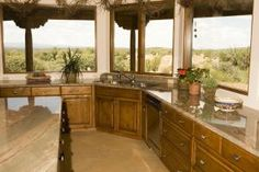 Granite Vs. Corian: We Weigh The Pros and Cons: Kitchen With Slab Granite Counters
