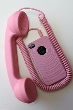 I have a pink corded phone that plugs into my cell phone!!! It's so entertaining to watch peoples faces as I walk around talking on it! LOL