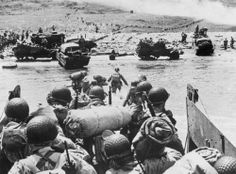 American soldiers and supplies arrive on the shore of Normandy during the Allied D-Day invasion on June 6, 1944.