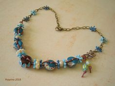 Four of my polymer clay beads, one lamp-worked bead (not by me). This necklace was inspired by one in Lorelei Eurto's Bohemian Jewelry. A great source of inspiration!