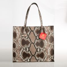 """What makes shopper 5045 a very glamorous and chic item is the soft python leather used for its realization, here in the elegant Taupe tonality ( a mix of dark brown, beige and Roccia), a sober and delicate tonality, perfect in any season of the year.  ITEM: 5045 MANUFACTURE: 100% Made in Italy. Genuine Italian Craftsmanship. MEASURES: cm. 39x34x10 ( 15.35""""x 13.38""""x 3.93"""") OUTSIDE COMPOSITION:Genuine Reticulatus python. Scientific name: Python Reticulatus. LINING: Brown fabric with python…"""