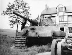 The German Tiger II tank 213 at La Gleize, Belgium before its restoration. Note the anti-tank damage.