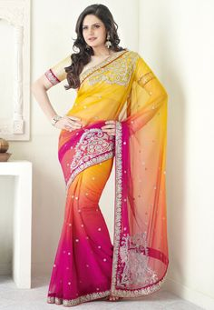 Zarine Khan in Vibrant Yellow & Dark Pink Net #Saree by http://www.UtsavFashion.in/saree/yellow-and-dark-pink-net-saree-with-blouse/sts2261-itemcode @ Rs 10050