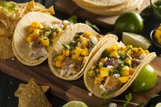 Simple grilled fish tacos with mango salsa will brighten up your Tuesday. #TacoTuesday