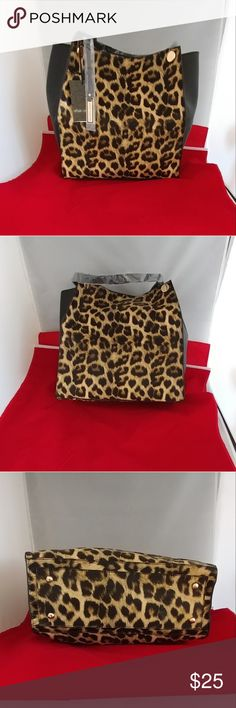 """Urban Originals leopard tote New with tag. Gold hardware. Snap closure. Double strap drop 10"""". 12""""L x 12""""H x 5""""D. Comes with pouch that doubles as a cross-body bag with removable strap. Bags"""